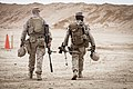 U.S. Marine Corps Cpl. Darek Kelsey, left, and Lance Cpl. William Tipper, both scout snipers assigned to the 3rd Battalion, 4th Marine Regiment, make their way to the firing line at a live-fire range at Camp 130323-M-RO295-011.jpg