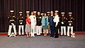 U.S. Marine Corps Gen. John M. Paxton Jr., center left, the assistant commandant of the Marine Corps and the Evening Parade host, and his wife, Debbie, center right, and other Marines pose for a photo with Coast 130607-M-KS211-038.jpg