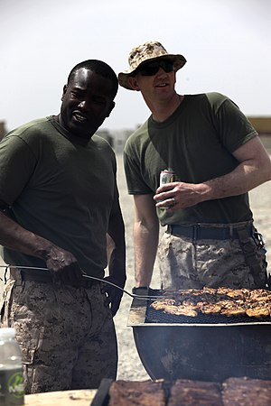 Psychology of eating meat - Image: U.S. Marine Corps staff noncommissioned officers with Combat Logistics Company 28, Combat Logistics Regiment 2 prepare meat for their company barbecue at Camp Dwyer in Helmand province, Afghanistan, April 3 130403 M KS710 022