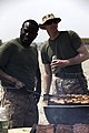 U.S. Marine Corps staff noncommissioned officers with Combat Logistics Company 28, Combat Logistics Regiment 2 prepare meat for their company barbecue at Camp Dwyer in Helmand province, Afghanistan, April 3 130403-M-KS710-022.jpg