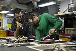 U.S. Navy Aviation Support Equipment Technician Airmen Christopher Hennen, left, and Branden Kelley perform maintenance on a spotting dolly aboard the aircraft carrier USS Harry S. Truman (CVN 75) March 8, 2014 140308-N-CC806-008.jpg