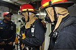 U.S. Navy Chief Damage Controlman Marcus Fuqua, left, a damage control training team chief, instructs two investigators responding to a flooding casualty drill aboard the aircraft carrier USS George Washington 140102-N-TE278-008.jpg