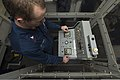 U.S. Navy Sonar Technician (Surface) 2nd Class Royce Fletcher operates the winch control console during a multi-functional towed array retrieval aboard the guided missile destroyer USS Mason (DDG 87) Jan. 3 140103-N-PW661-012.jpg