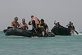 U.S. Sailors with Riverine Squadron 3, Detachment 2, Regimental Combat Team 5, paddle a Zodiac raft while racing Iraqi Policemen in Lake Quadsiyah in Haditha, Iraq, July 9, 2008 080709-M-QJ743-005.jpg