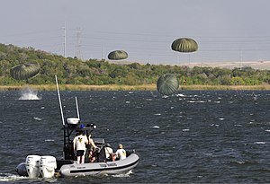 Lake Walter E. Long - Image: U.S. Soldiers from Charlie Company, 1 19th Special Forces Group, 71st Battlefield Surveillance Brigade, the 147th Air Support Operations Squadron and the 249th Quartermasters Company land in Walter E. Long Lake 120908 A XN953 660