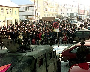 Vitina - A protest in Vitina, monitored by KFOR troops, January 2000.
