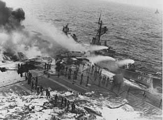 USS Rogers (DD-876) - Image: USS Rogers (DD 876) alongside burning USS Enterprise (CVN 65)