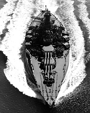 The U.S. Navy battleship USS Tennessee (BB-43) underway on 12 May 1943. Tennessee was damaged in the Japanese attack on Pearl Harbor 7 December 1941 and was afterwards given a very extensive reconstruction. This gave her the enormous beam apparent in this photograph.