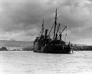 USS Vestal - USS Vestal beached and listing, after being hit in the Pearl Harbor Raid, 7 December 1941.