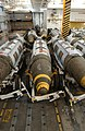 US Navy 030228-N-4953E-005 2000 pound Joint Direct Attack Munition (JDAM) GBU-32 bombs stand ready for transport and loading on air wing aircraft, in a weapon's magazine aboard USS Harry S. Truman.jpg