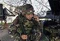 US Navy 030612-N-4936C-036 Boatswain's Mate 2nd Class Julian Quiroz talks on a sound powered telephone during a General Quarters drill.jpg