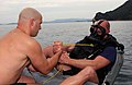 US Navy 031014-N-2420K-005 Lt. Ryan Bedner lowers (EOD) dive officer, Cmdr. Mark Sanders, into Sasebo Bay.jpg