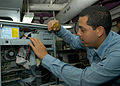 US Navy 040128-N-5952R-001 Information Systems Technician 3rd Class Joe Rivera from Lapuente, Calif., conducts maintenance on one of the nuclear-powered aircraft carrier's hundreds of desktop computers.jpg
