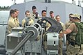 US Navy 040728-N-7949W-001 A Sailor assigned to the coastal patrol ship USS Monsoon (PC 4) explains to a group of Naval Reserve Officer Training Corps (NROTC) Midshipmen, the capabilities of the Mk 38 25mm machine gun.jpg