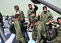 US Navy 040810-N-7128D-004 The crew of Motor Vessel EDHA II are greeted by a coalition small boat crew.jpg