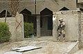 US Navy 041208-N-4614W-008 Master Chief Utilitiesman Pete Sansom secures a perimeter position at a school in Fallujah, Iraq.jpg