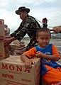US Navy 050103-N-9293K-133 A young Indonesian boy watches the humanitarian relief efforts at Sultan Iskandar Muda Air Force Base in Banda Aceh, Sumatra, Indonesia.jpg
