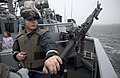 US Navy 050531-N-9851B-008 Gunner's Mate 3rd Class David Rizkallah stands force protection watch with an M-240 machine gun on the bridge wing of the guided missile destroyer USS John S. McCain.jpg