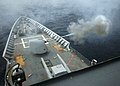 US Navy 050713-N-4374S-001 The guided missile cruiser USS Thomas S. Gates (CG 51) fires a training round from an MK-45 5-inch-54 caliber lightweight gun during a live fire exercise in the Pacific Ocean.jpg