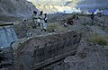 US Navy 051113-F-2729L-021 A U.S. Navy Seabee assigned to Naval Mobile Construction Battalion Seven Four (NMCB-74), levels the ground in Muzaffarabad, Pakistan.jpg