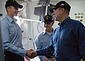 US Navy 060130-N-8997S-021 Secretary of the Navy (SECNAV), the Honorable Dr. Donald C. Winter, meets Seaman Christopher Cotterman.jpg