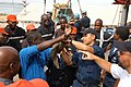 US Navy 060324-N-2420K-049 Members of the Congolese Military gather around as Hospital Corpsman 3rd Class Darnell Sales, assigned aboard the submarine tender USS Emory S. Land (AS 39), demonstrates the proper procedures for app.jpg