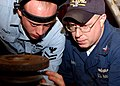US Navy 070103-N-3285B-051 Hull Technician 2nd Class Christopher French and Mervin Bailey inspect welds on an expansion bellows that they are repairing for the guided-missile cruiser USS Hue City (CG 66).jpg