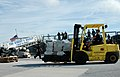US Navy 070105-N-5240C-018 Boatswain's Mate 1st Class David Malcolm of Naval Air Station (NAS) Key West use a forklift to transport a pallet of cocaine onto a waiting truck at the pier at NAS Key West.jpg