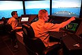 US Navy 070516-N-9241M-004 Surface Warfare Officer's School (SWOS) students navigate their virtual vessel through a number of simulated hazards in the school's full-mission bridge. Simulators have become a mainstay of training.jpg