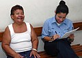 US Navy 070629-N-4238B-100 Hospital Corpsman 1st Class Wanda Ziehr, a patient administrator for the Military Sealift Command (MSC) hospital ship USNS Comfort (T-AH 20), shares a laugh with a patient at Puerto Barrios National H.jpg