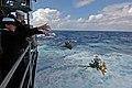US Navy 070726-N-7883G-012 Yeoman Seaman Jessica Gardner and Yeoman Seaman Whitney Utter throw flowers overboard as USS Kitty Hawk (CV 63) passes the final resting place of USS Lexington (CV 2).jpg