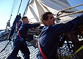 US Navy 070801-N-2385B-001 Working on USS Constitution's bowsprit, Seaman Apprentice Andrew Lewis (right) and Seaman Bob Griffiths work with other Sailors at setting and furling the jib.jpg