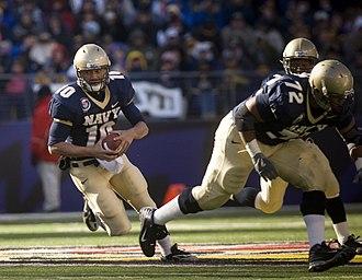 2007 Poinsettia Bowl - Image: US Navy 071201 N 0696M 372 Naval Academy Midshipmen Quarterback Kaipo Noa Kaheaku Enhada (10) rushed for 27 yards during the Midshipmen's 38 3 victory