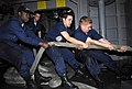 US Navy 080927-N-9610C-039 Sailors assigned to the deck department of the Nimitz-class aircraft carrier USS John C. Stennis (CVN 74) heave a mooring line on the fantail as the ship moors pierside at Naval Air Station Coronado.jpg