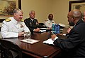 US Navy 090406-N-8273J-064 Chief of Naval Operations (CNO) Adm. Gary Roughead, left, meets with acting Secretary for Defense Mr. Tsepe Motuni, right and other senior leadership during a conference call at the Defense Headquarte.jpg