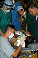 US Navy 090522-N-1159B-070 Philippine and U.S. Navy medical personnel treat a patient at a medical civic action program during exercise Cooperation Afloat Readiness and Training (CARAT) 2009.jpg