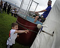 US Navy 090731-N-7280V-440 Capt. Thom W. Burke, commanding officer of the amphibious command ship USS Blue Ridge (LCC-19), gets dunked in the dunk tank by the son of a Blue Ridge officer.jpg