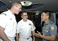 US Navy 090824-N-5060D-069 Musician 2nd Class John Wylie, left, and Musician 3rd Class Charles Perkes, assigned to Commander, U.S. 7th Fleet Band, meet an Indonesian sailor after the opening ceremony of Cooperation Afloat Readi.jpg