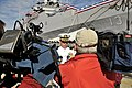 US Navy 090930-N-3595W-023 Cmdr. Brian Peterson, officer-in-charge of the amphibious transport dock ship USS Nashville (LPD 13), answers questions about the ship for local media before the ship's decommissioning ceremony.jpg