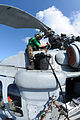 US Navy 091016-N-0890S-027 Aviation Structural Mechanic Airman Colton Green services a rotor head on an MH-60S Sea Hawk helicopter.jpg