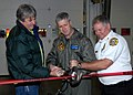 US Navy 091215-N-9860Y-003 Capt. Gerral David, John Hodges and Chief John Arruda perform a ribbon-cutting with the Jaws of Life during a reopening ceremony for the Navy Region Nortwest Fire and Emergency Services Fire Station 7.jpg