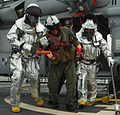 US Navy 100202-N-7058E-266 Flight-deck crewmen carry a simulated casualty away from an MH-60S Sea Hawk helicopter during an emergency landing drill aboard the littoral combat ship USS Freedom (LCS 1).jpg