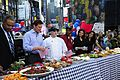 US Navy 100529-N-3041C-068 Navy Culinary Specialist 1st Class Keith Combo and Coast Guard Food Service Specialist 2nd Class Robert Runn compete in a cookout on ABC's Good Morning America in Times Square.jpg