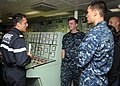 US Navy 100618-N-3327M-064 Capt. Renaud Bondil, commandant of the French navy frigate FS Prairial (F 731), describes the engine control room of Prairial to Sailors assigned to the guided-missile cruiser USS Chosin (CG 65).jpg