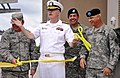US Navy 100630-D-5422E-003 Rear Adm. William R. Kiser, commandant of the Joint Medical Education and Training Center, middle, celebrates cutting the ribbon to open the training center at Fort Sam Houston.jpg