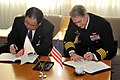 US Navy 110131-N-2986M-005 Mayor of Chigasaki City Nobuaki Hattori, left, and Capt. Eric Gardner, commanding officer of Naval Air Facility Atsugi,.jpg