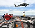 US Navy 110312-N-0864H-211 Sailors aboard the U.S. 7th Fleet command ship USS Blue Ridge (LCC 19) stand-by to move pallets of humanitarian relief s.jpg
