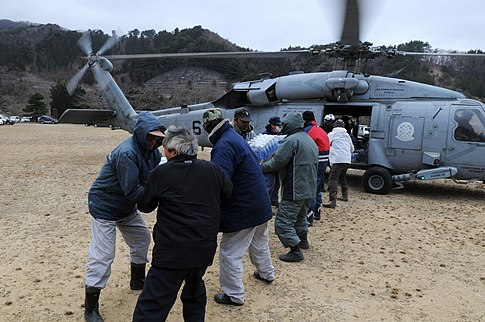 Japanese citizens receive supplies from the crew of a U.S. Navy helicopter. Image: U.S. Navy.