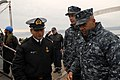 US Navy 110614-N-ZI300-016 Cmdr. Roy Love, commanding officer of the guided-missile frigate USS Boone (FFG 28) is greeted by senior leadership of t.jpg