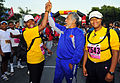 US Navy 110618-N-KB563-161 Xanana Gusmao, the Prime Minister of Timor-Leste, high fives Cmdr. Veronica Armstrong during the Marathon for Peace race.jpg